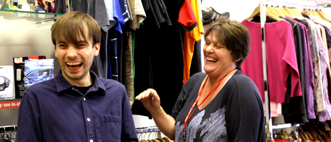 Two volunteers laughing in Shelter shop