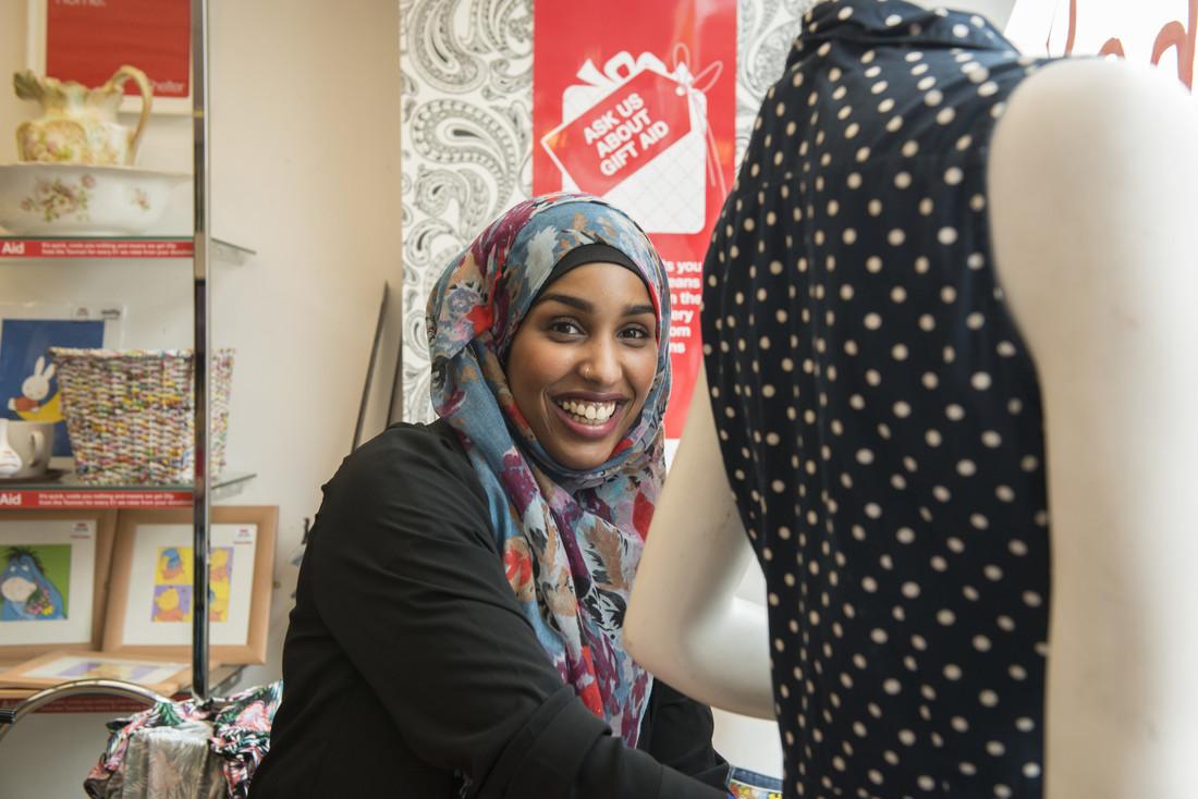 Smiling volunteer in Shelter shop