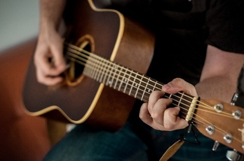 Person playing guitar
