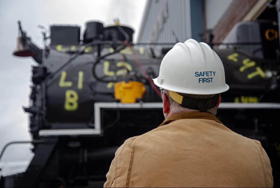 A man with a hard hat looks at 2716