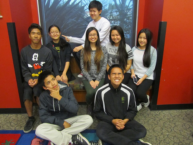 Teen volunteers sitting on bench at Library